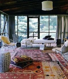 Why decide on just one rug? Layering creates a dynamic interesting look. Pair them with minimalist furniture and you can't go wrong. Keep in mind that you should choose thin rugs that stay in place! Layering can create a tripping hazard.