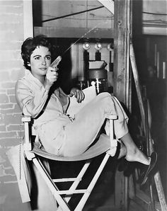 Elizabeth Taylor, armed and dangerous. Capture the memories of your era for posterity at http://www.saveeverystep.com