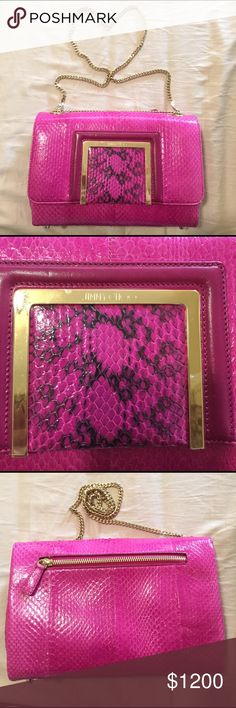 Jimmy Choo Bag I've used this bag 3 times, I love it but I'm so scared of anything happening to it so it's been siting in the dust bag for a year almost now. This bag always gets compliments and makes any outfit look amazing! The color is super vibrant. The plastic protection is still on the front hardware. Mint condition. Python skin. No odor, pet and smoke free home. Comes with dust bag and authenticity card. Jimmy Choo Bags