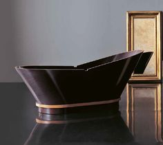 Luxury space with Treesse's modern wooden bathtub / Calypso Collection