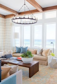 Cozy, large-scale slipcovered furnishings transform what might have ordinarily been a formal living room into a beacon of casual gathering. - Photo: Alyssa Rosenheck / Design: Chad James