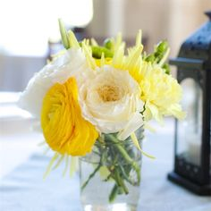 Yellow and White Mason Jar Centerpiece. I'd like to make this a little more wild for you.