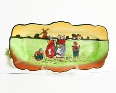 Vintage hand painted serving platter with Dutch scene, made in England, H&K Tunstall by CardCurios on Etsy Vintage High Tea, Dutch Women, Side Plates, Serving Platters, Windmill, England, Scene, Hand Painted, Shapes