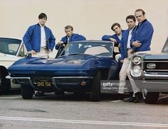 Rock and roll group 'The Beach Boys' pose with Corvette in their first photo session since Al Jardine returned to the band in Novermber (L-R) Brian Wilson, Al Jardine, Dennis Wilson, Carl Wilson, Mike Love. Carl Wilson, Dennis Wilson, Mike Love, Charles Manson, Corvette C2, Chevrolet Corvette, Chevy, The Beach Boys, Boys Home