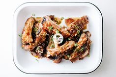 Kalbi Baby Back Ribs 1/2 CUP SOY SAUCE 1/4 CUP BROWN SUGAR 1/2 PEAR, MINCED WITH JUICES OR FINELY GRATED 2 TABLESPOONS SESAME OIL 2 TABLESPOONS RICE VINEGAR 8 CL...