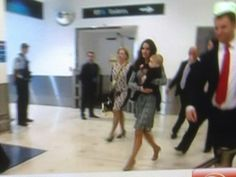 Kate and George travelling through the Sydney Airport on their way to their second air trip of the day to New Zealand.