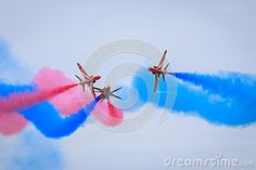 The Red Arrows demo team of the Royal Air Force performing a maneuver where it seems the jets are flying into each other.