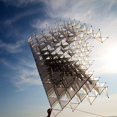 Beautiful and light, kites are tethered aircraft which harness the power of the wind. While kites come on all shapes and sizes, this gorgeous cube-shaped sculpture by UK-based artists Heather and Ivan Morison also doubles as a kite, even though it initially seems too heavy to fly.