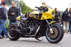 Liberty Yam has created a stunning tribute to legendary French Yamaha icon Jean-Claude Olivier 'JCO' with a muscular Café-Dragster build in 60th anniversary yellow and black colours. The Café-Dragster, which won the 2015 Yamaha Dealer Built Contest for the VMAX category, is a very rarely seen take on the powerful street bruiser that celebrates its 30th anniversary this year. Many of its pieces are one-off hand made designs.