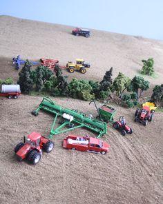 Planting peas on the model farm.