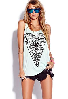 """Graphic-design shirts are so in right now. And great news, they sell them everywhere! This one, the """"tribal triangle"""", is one of my favorites. Graphic tees can be paired with almost anything. Shorts, leggings, scarves, sunglasses, colored jeans, big belts, etc. Make the look yours! -Kimberlee"""