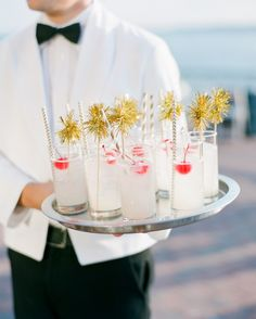 The second signature sipper was a gin fizz—each garnished with chevron straws, gold pom-pom stir sticks, and a cherry.