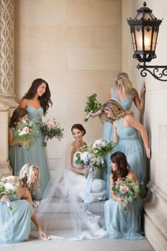 Every bride gets by with a little help from her 'maids: http://www.stylemepretty.com/north-carolina-weddings/asheville/2015/10/05/traditional-elegant-outdoor-biltmore-estate-wedding/ | Photography: Jill Schwarzkopff - http://realitiesphotography.com/