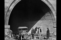First car through Hill Street tunnel, 1913 | March 22, 1913: Contractors drive a car out of the Hill Street tunnel at 1st Street, a few minutes after a steam shovel had removed the last foot of dirt.  This tunnel was the second of twin bores through the northeastern section of Bunker Hill. The hill was also referred to as Court Hill. The tunnel connected Temple St. with 1st Street.  This photo accompanied a story in the March 23, 1913, Los Angeles Times that report...