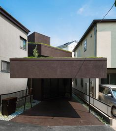 Makiko Tsukada's Grass Cave House Attributes Rooftop Lawns And A Dark Interior - http://www.dailywomanmag.com/hairstyle/makiko-tsukadas-grass-cave-house-attributes-rooftop-lawns-and-a-dark-interior.html