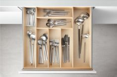 Kitchen Drawer Organization - Design Your Drawers So Everything Has A Place // Wide compartments in this cutlery drawer provide lots of space for storing things and has room for larger utensils that need somewhere to go.