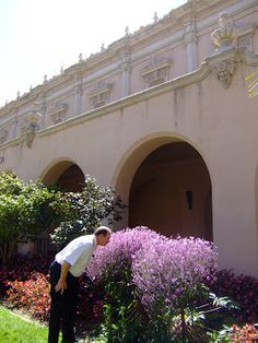 My hubby taking time to smell the flowers at Balboa Park in San Diego, CA.