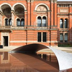 "Zaha Hadid has installed a reflecting pool crossed by a shimmering ""bridge"" in the V&A museum's John Madejski Garden for London Design Festival 2014."