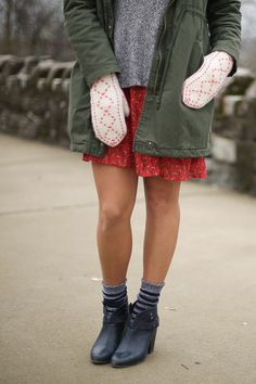 Winter accessories. Green parka, handmade mittens, gray sweater, floral skirt, bootie socks. How to accessorize for Winter. Winter outfit.