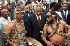ANC president Nelson Mandela is surrounded by men wearing traditional Zulu dress, at a cultural day in Durban on 24 October 1993