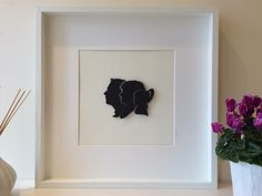 Silhouette Family Portrait with 3D Effect in a Large 50 x 50 cm White Box Frame, also available in Black Frame. We can design your own family to create a piece of art that can be treasured for years to come. Prices start at £59.99 for a family of 3, additional members typically cost £5. #silhouette