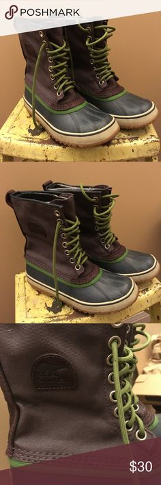 Sorel Winter Snowboots Deep Purple and Navy Blue Sorel winter snowboots, canvas and rubber, handcrafted, deep purple and navy blue with a dash of green, women's size 7, only worn once or twice, in perfect condition, basically brand new! Sorel Shoes Winter & Rain Boots
