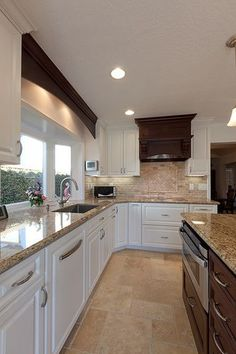 white cabinets and love the floor and backsplash combo. Interesting use of dark wood on vent and over sink. Would this work without an island to balance it out?