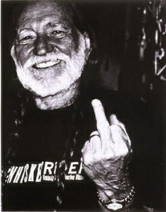 Willie Nelson giving middle finger