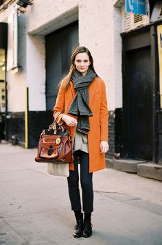 Love the scarf and orange coat