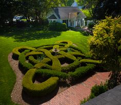 Symmetry & Order: Knot Garden.. this garden is out of scale and setting for this house.
