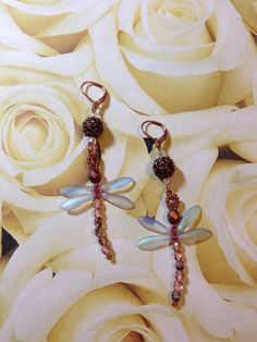 Sunday Earring Challenge. Wired Dragonfly Earrings. Made with 28 gauge wire, Czech beads, seed beads, copper accent beads and daggers. Design by Irene Hoffman, Heart's Dezire