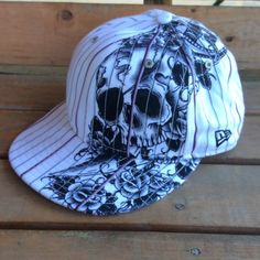 White with pinstripes pink and black skull on sword design cap