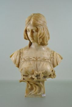 Art nouveau gilded bronze and alabaster bust of a young woman on a small waisted pedestal by Belgian sculptor Antonio Frilli (1873 - 1927).