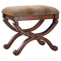 "Add timeless style to your master suite or den with this Savonarola-style ottoman, showcasing leopard-print upholstery and nailhead trim. Product: OttomanConstruction Material: Wood and fabricColor: Brown, black and ivoryFeatures: Curved legsNailhead trimLeopard-print Dimensions: 22"" H x 24"" W x 15"" D"