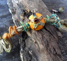 Items similar to Lampwork bracelet heady glass star bead wire wrapped bracelet with woolywire on recycled sari ribbon by Genea Crivello of Third Eye Gypsy on Etsy Wire Wrapped Bracelet, Beaded Bracelets, Silk Ribbon, Third Eye, Lampwork Beads, Hippy, Wire Wrapping, Sari, Facebook