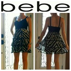 Bebe Dress Adorable Bebe Short Mini Dress.  Fitted black V Neck, with B&W zebra design on ruffled bottom. Worn once in PERFECT CONDITION! bebe Dresses