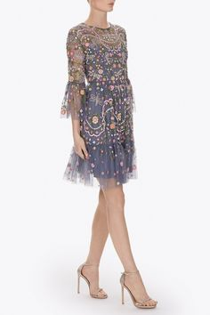 The Dragonfly Garden artwork is inspired by formal English gardens, with beautifully soft, delicate pastel florals and shimmering beaded dragonflies floating throughout. The dress silhouette is created in semi-sheer tulle with Victorian-style detailing in the form of fluted, voluminous sleeves and a full tiered skirt.