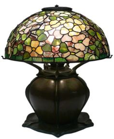 Lamps with bulbous bases were originally made to burn fuel. Later, Tiffany produced electrified versions as well as oil lamps. Some of the oil lamps were converted to electricity