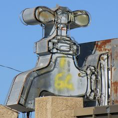 Faucet sign in Oklahoma City. Photo by Dave van Hulsteyn, via Flickr