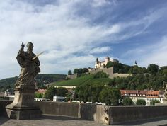 Statues of saints and German leaders line The Old Bridge over the Main River