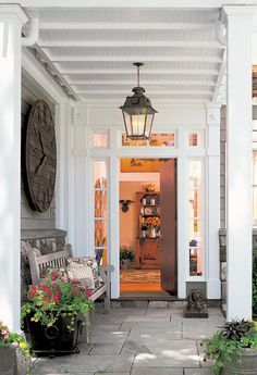 pretty porch ~ I love the big wood clock