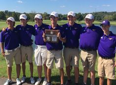 The boys' golf team celebrates finishing runner-up at the district championship