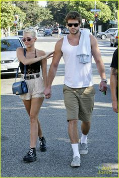 f84af2ceb3 Miley rocks her  Patti Goes to Paris  frames while out doing errands with  her fiancee.