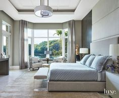 Gray and Briwn Master Bedroom with Large Window and Lucite Chair