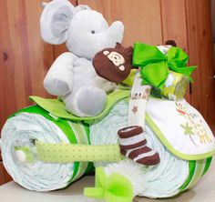 vehicle safari diaper cake:  The cake stands approx. 12 inches tall and 17 inches long (at base), without the height of the elephant. Size 3 diapers are used for this cake.