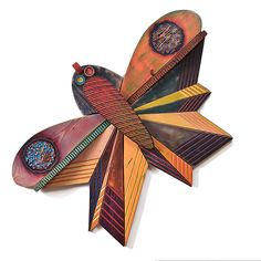"Functional and fab and more than 5 feet across.. ""Big Bug""  Wood Wall Art created by James Nelson.  This wood painting is created with various woods ~bass wood, cedar and/or pine. Then shaped, carved and painted with acrylic. There are two rounded ""shelves"" just below the large circles on the wings, that make this painting functional art, if hung straight upright. www.artfulhome.com/product/Wood-Wall-Art/No.-125,-Big-Bug/67435"