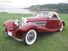 wow, red two door roadster convertible with great swooping fenders and terrific chrome details 1935 Mercedes-Benz 540K