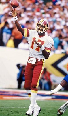 Washington Redskins QB Doug Williams became the first African-American to win a Super Bowl as a starting QB. He guided the 'Skins to a 42-10 woodshed job of the Denver Broncos in SB XXII, including the orchestration of a 35-point second quarter that put the game out of reach before halftime. The Broncos finally managed to break free of the SB loss stigma in 1997 and 1998; winning back-to-back Super Bowls in John Elway's final two seasons as an NFL quarterback.