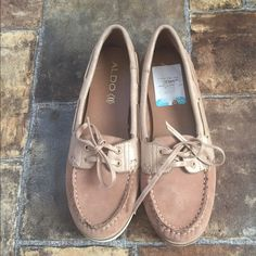 ALDO Boat Shoes NWOT These boat shoes are a must-have for lovers of flats!! These shoes are made with genuine leather and feature a tie detail. Although they are size 8, they run very small. Never worn! ALDO Shoes Flats & Loafers