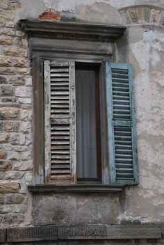 typical old window shutter in Bergamo (Italy)